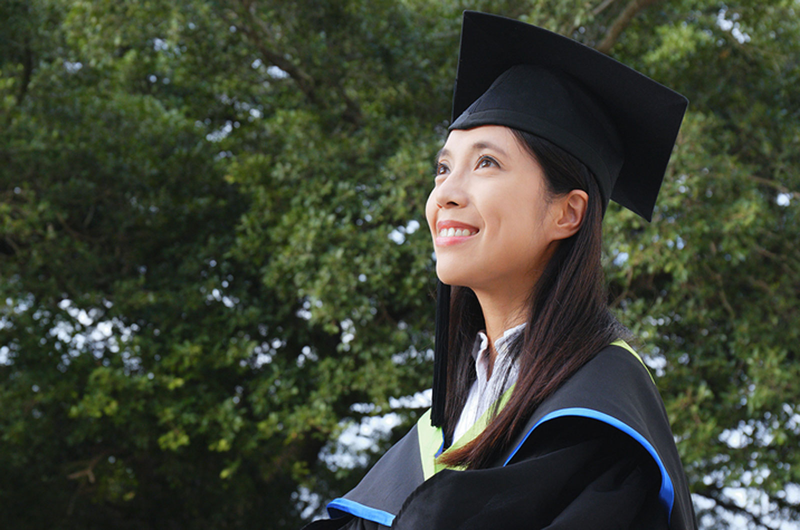 bigstock-Asian-woman-get-graduation-216584479